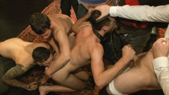 Brandon Moore in 'Horny party goers gangbang and fist a bound stud's ass'