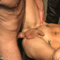 Dayton O'Connor in 'Kink Men' Horny crowd gang bangs a young stud at the playspace of Mr S Leather (Thumbnail 13)
