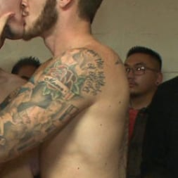 Eli Hunter in 'Kink Men' Horny crowd mercilessly gang fucks a bound hung stud against his will (Thumbnail 10)