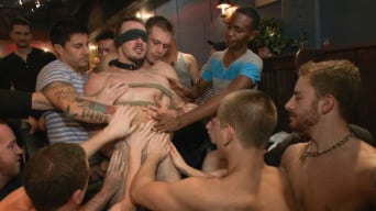 Kirk Cummings in 'Stud in a metal cage is fucked by horny bar patrons'