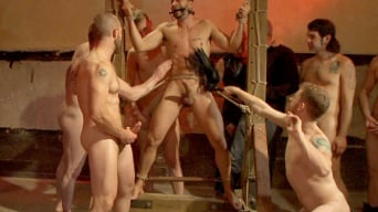 Ray Han in 'Bound hunk with an uncut cock gets gangfucked by a crowd of horny men'